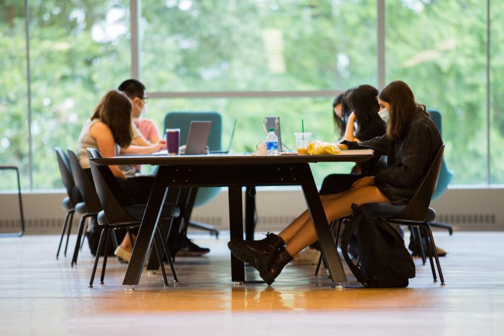 Students study at a table in the new library area that opened this fall
